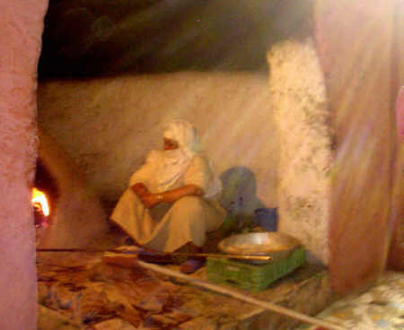 Berber Woman baking