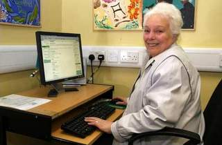 Pensioner on computer